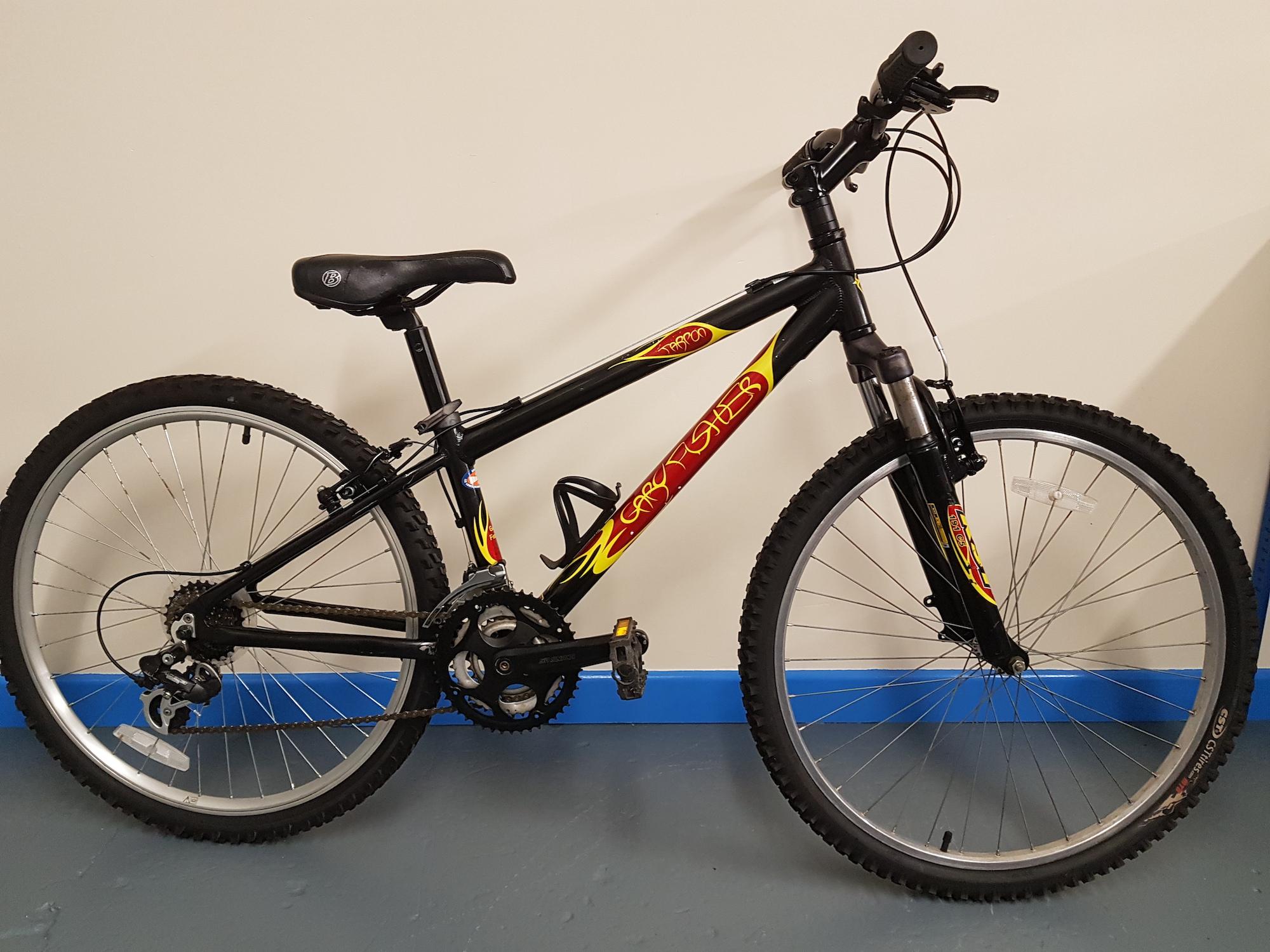 Black Mountain bike against a plain background